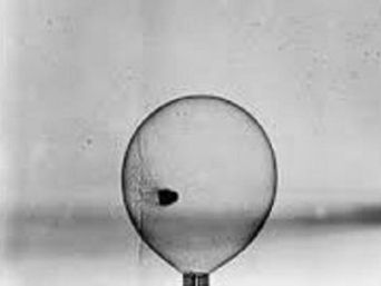 Ball Passing Through a Soap Bubble Poster